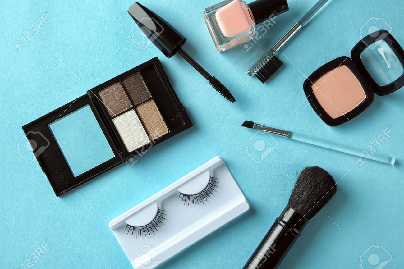 d12c6d38d02 Makeup set with false eyelashes on color background Stock Photo - 98662221