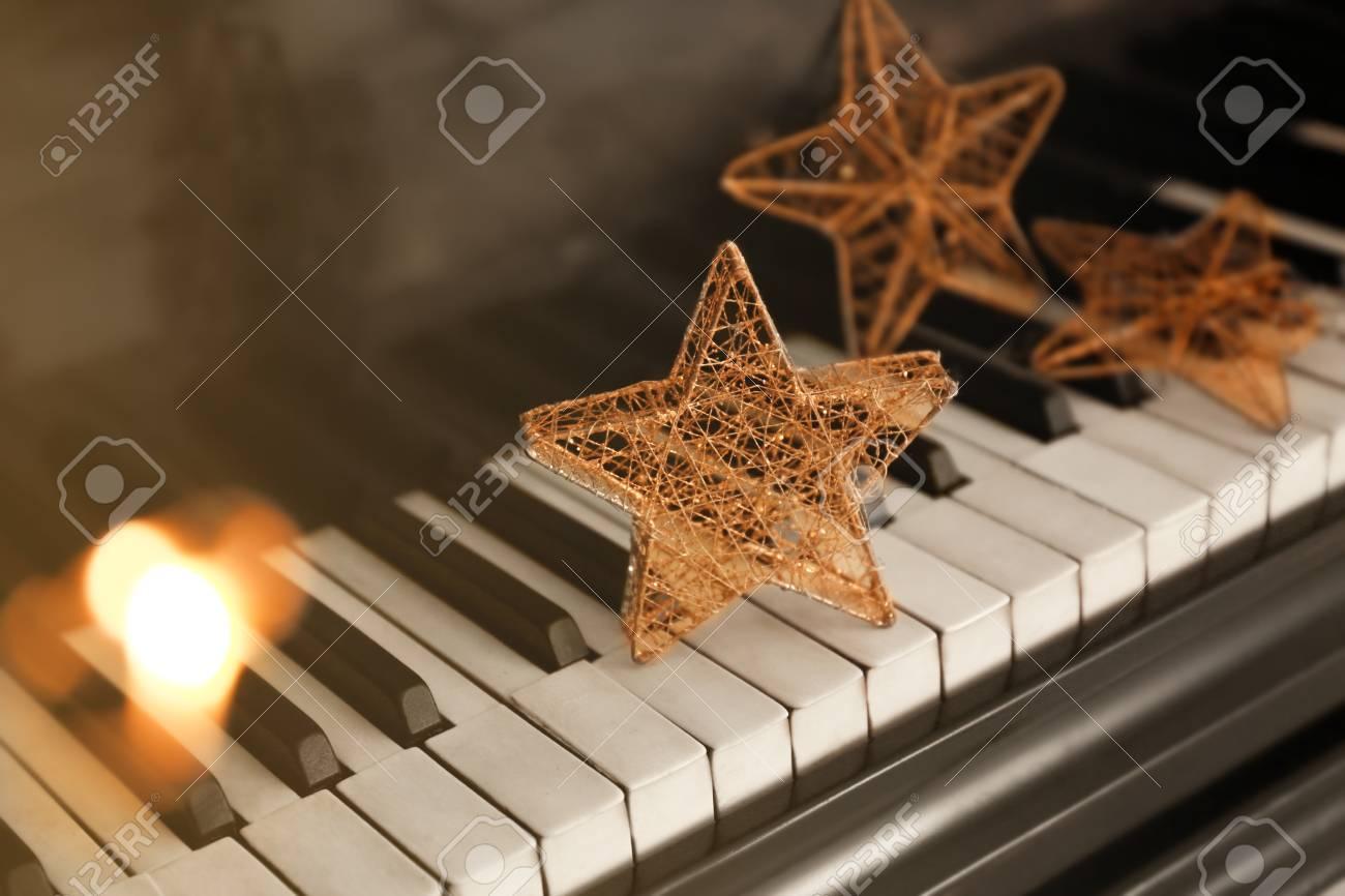 Piano keyboard with Christmas decoration, closeup - 98779211