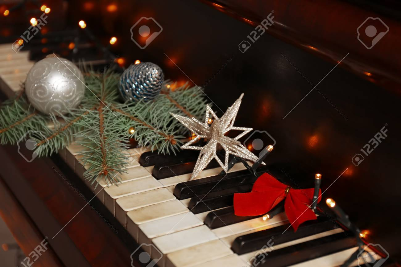 New Year Decorations On Piano Keyboard. Christmas Music Concept ...