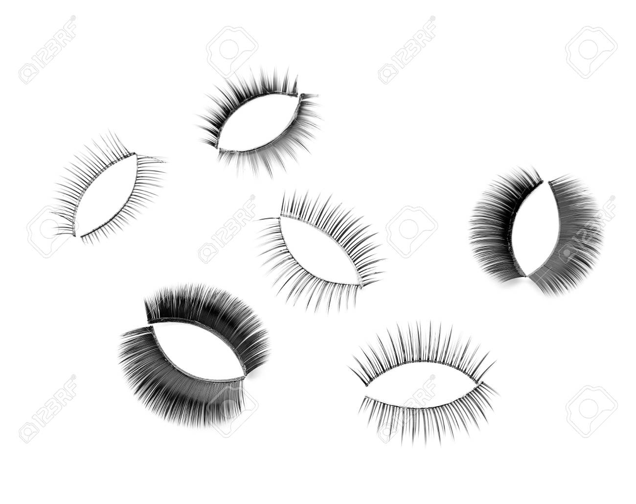 Different Types Of False Eyelashes On White Background Stock Photo