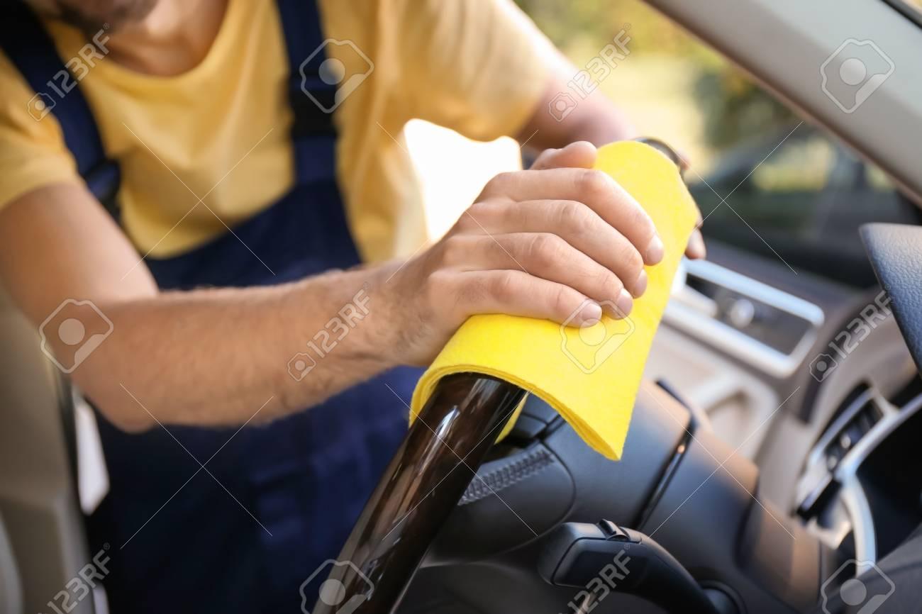 Steering Wheel Cleaner >> Man Cleaning Car Steering Wheel With Rag Closeup