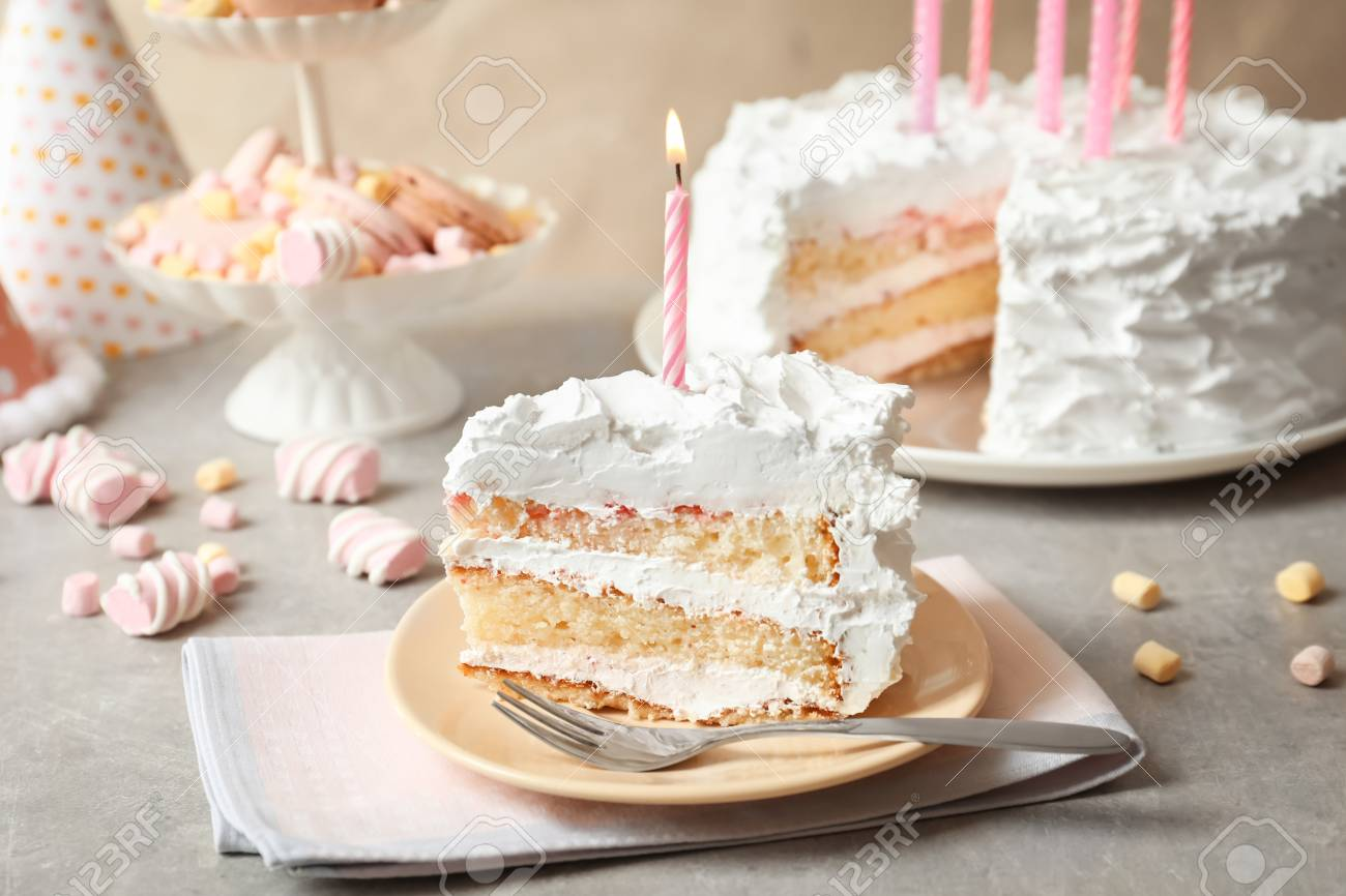 Wondrous Piece Of Birthday Cake With Candle On Table Stock Photo Picture Funny Birthday Cards Online Fluifree Goldxyz