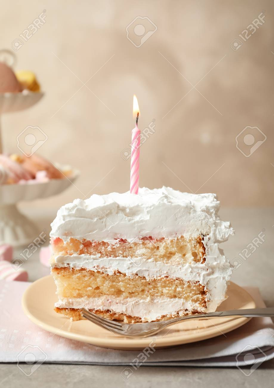 Marvelous Piece Of Birthday Cake With Candle On Table Stock Photo Picture Personalised Birthday Cards Petedlily Jamesorg