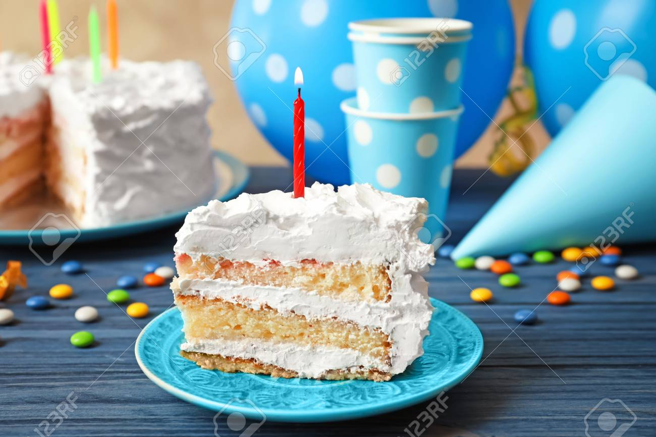 Superb Piece Of Birthday Cake With Candle On Table Stock Photo Picture Personalised Birthday Cards Petedlily Jamesorg