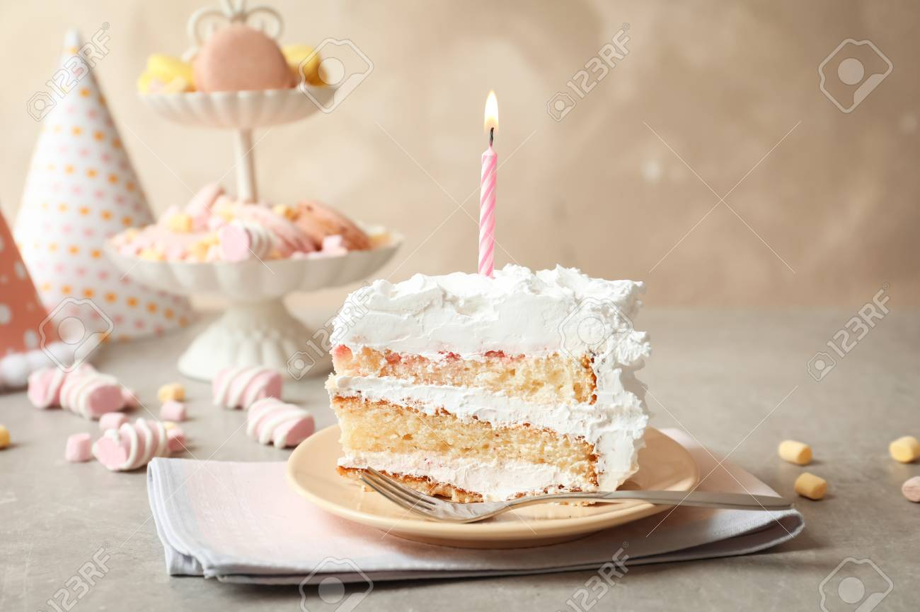 Super Piece Of Birthday Cake With Candle On Table Stock Photo Picture Personalised Birthday Cards Petedlily Jamesorg