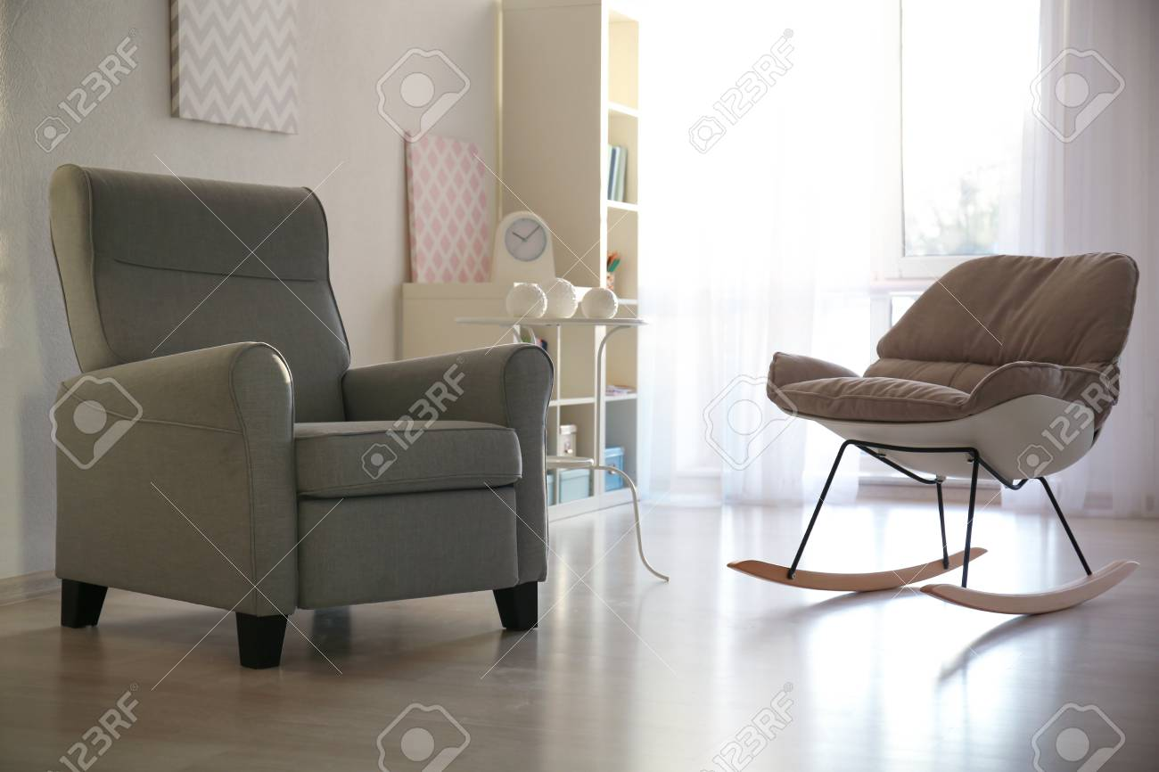 photo elegant living room interior with fortable armchairs