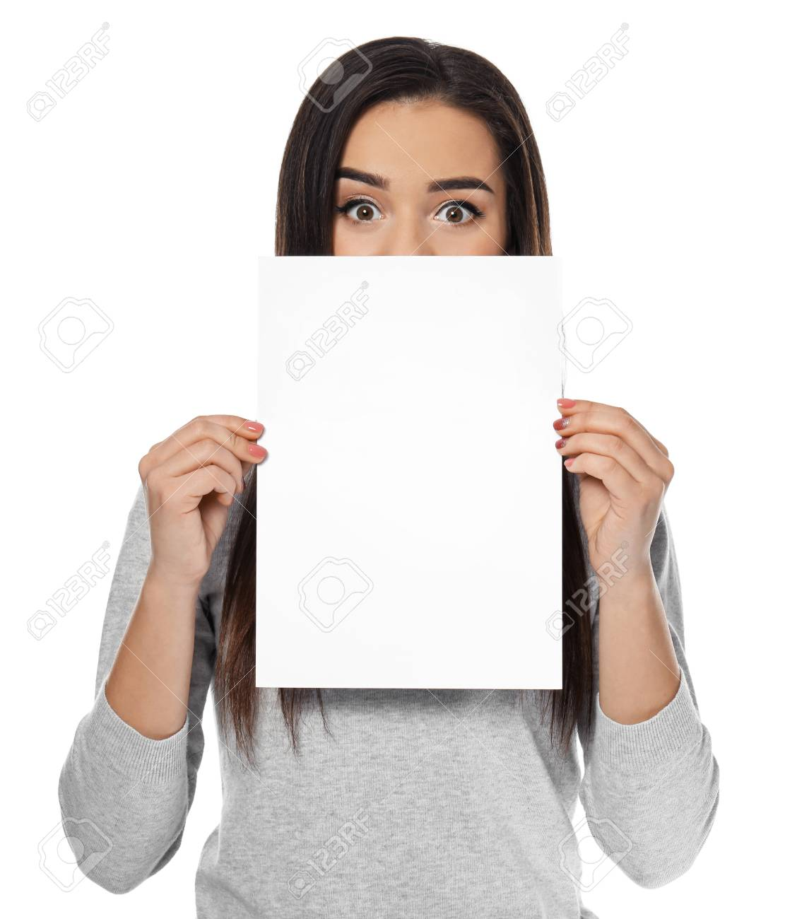 young woman with blank sheet of paper for advertising on white
