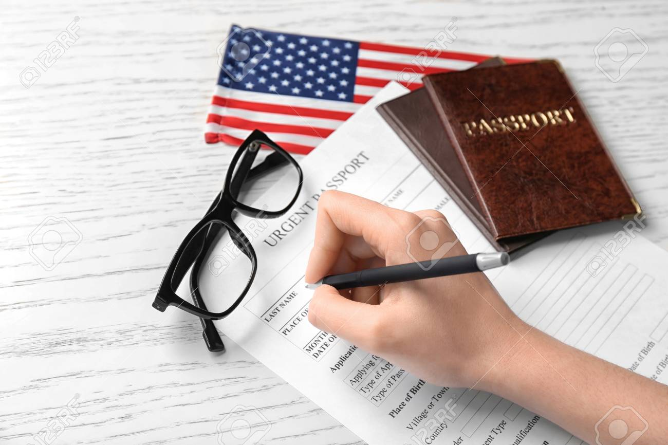 Woman Filling Urgent Passport Application Form Near American Stock