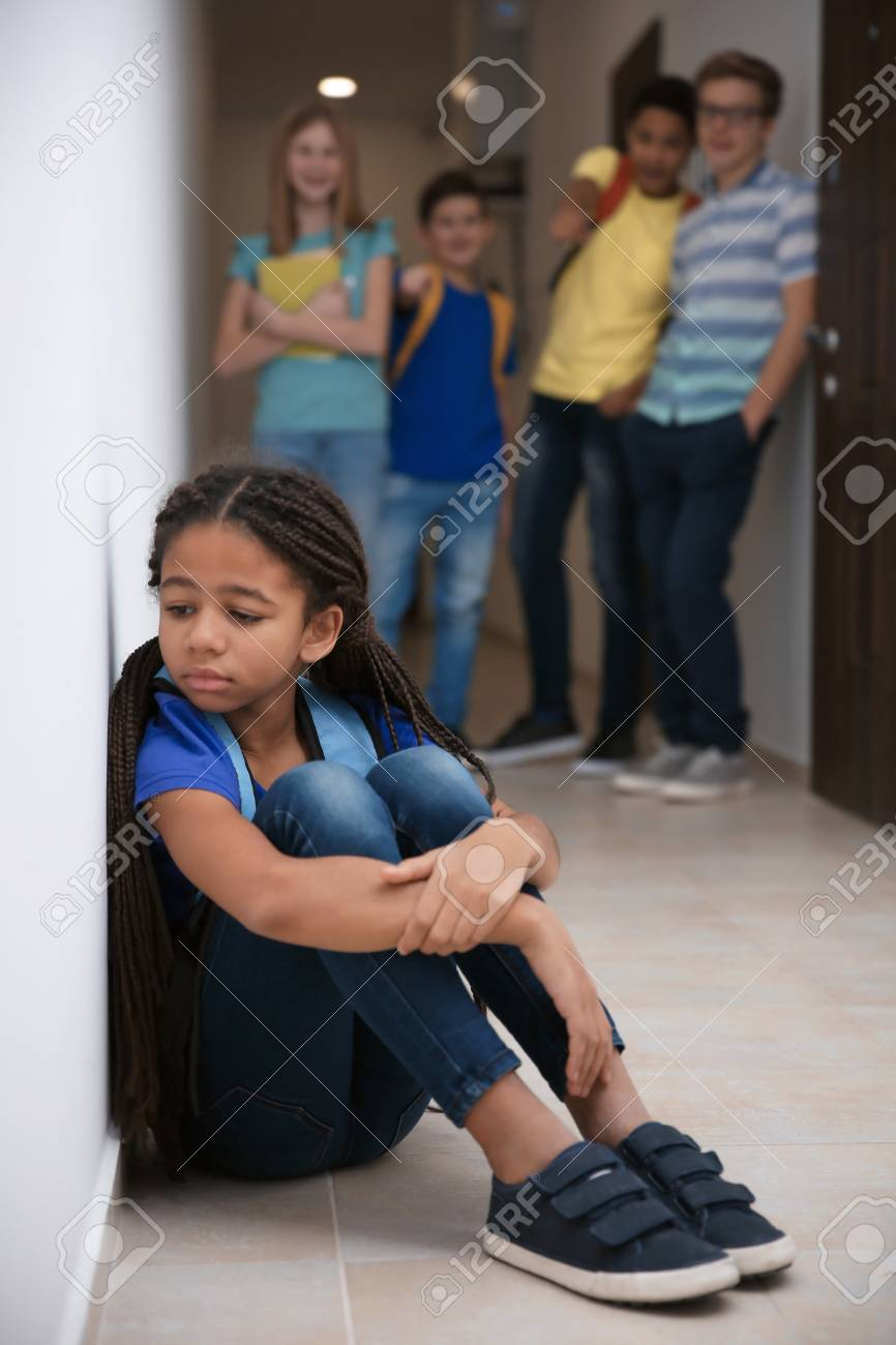 Sad African American girl indoors. Bullying in school - 100276979