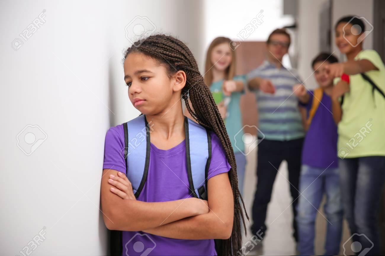 Sad African American girl indoors. Bullying in school - 100266766