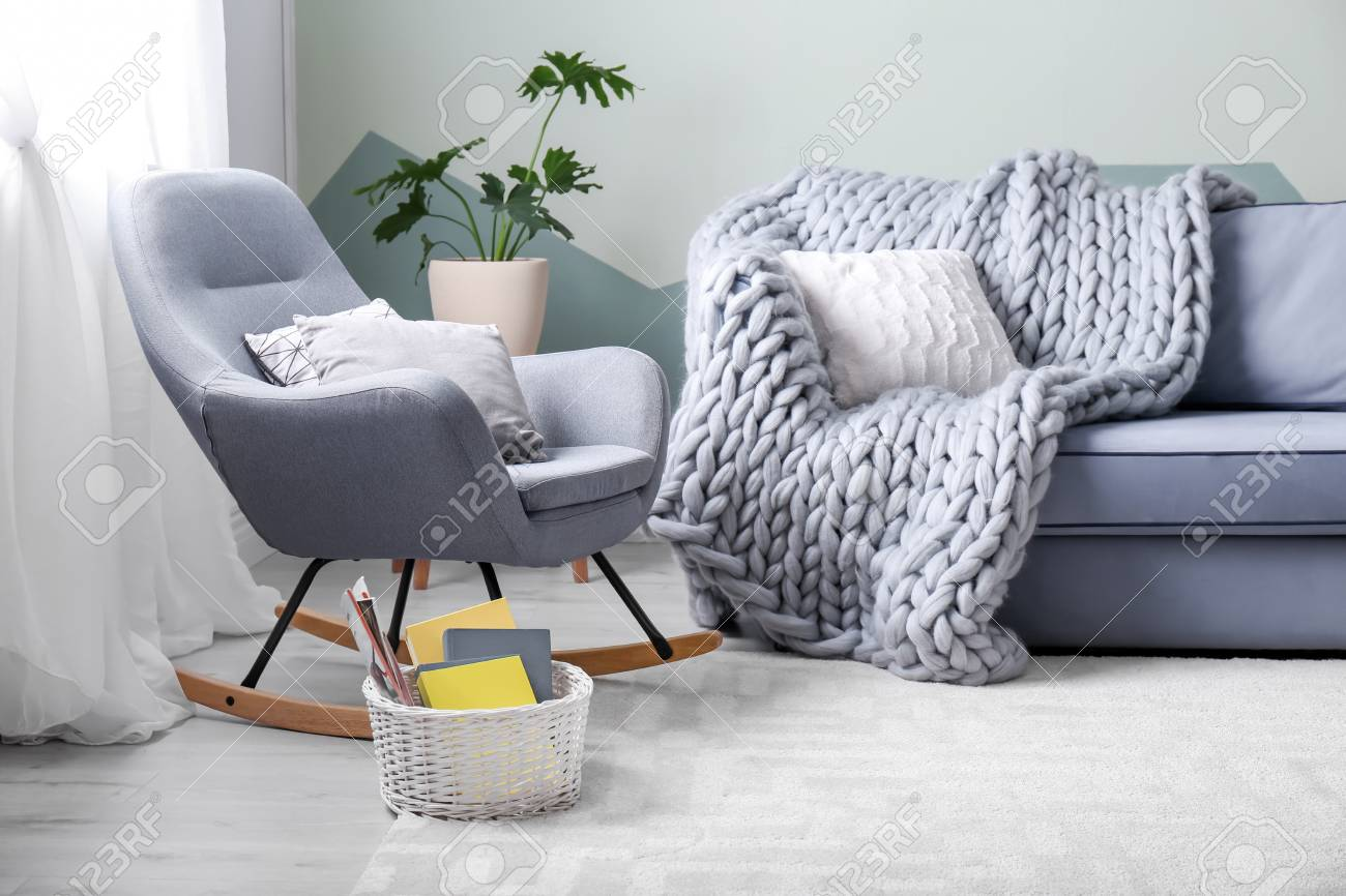 Stylish Living Room Interior With Comfortable Sofa And Rocking Stock Photo Picture And Royalty Free Image Image 105139709