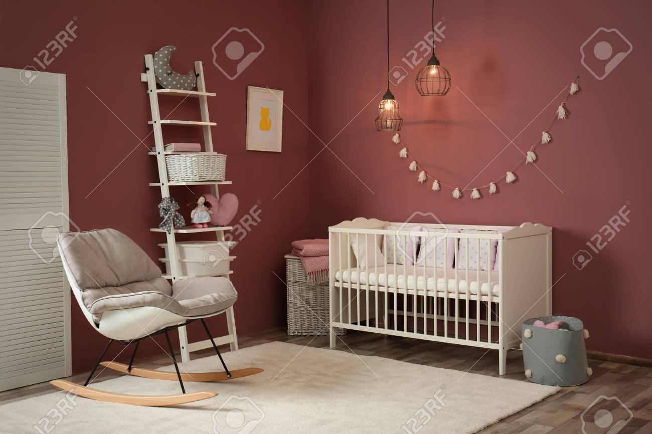 Cozy Baby Room Interior With Crib And Rocking Chair Stock Photo
