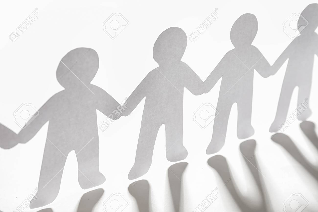 Paper people holding hands on light background  Unity concept