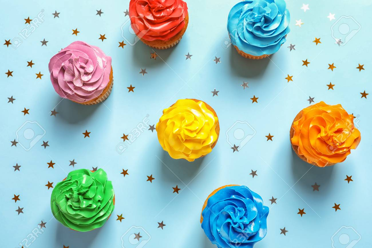 Flat Lay Composition With Colorful Birthday Cupcakes On Color Background Stock Photo