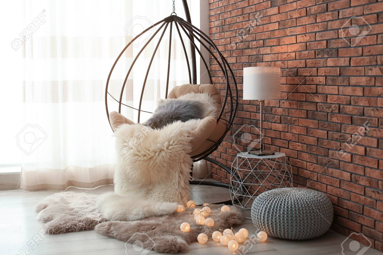 Comfortable Hanging Chair In Modern Living Room Interior Stock