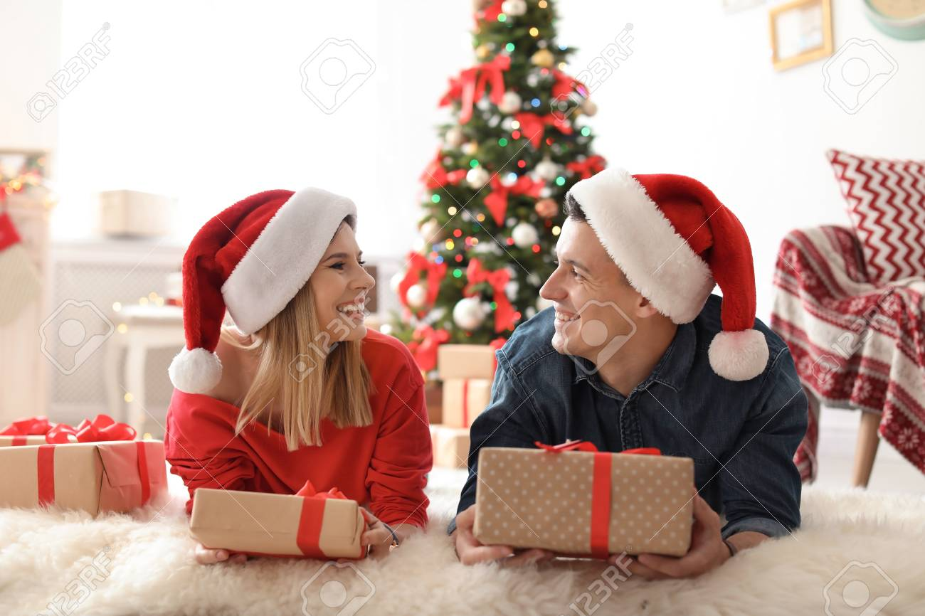 Young Couple With Christmas Gifts At Home Stock Photo, Picture And ...