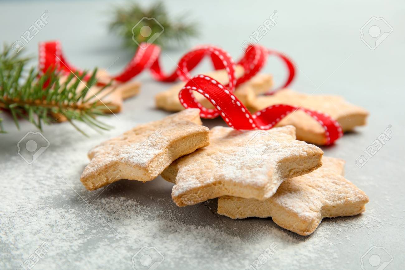 Tasty Homemade Christmas Cookies With Ribbon On Table