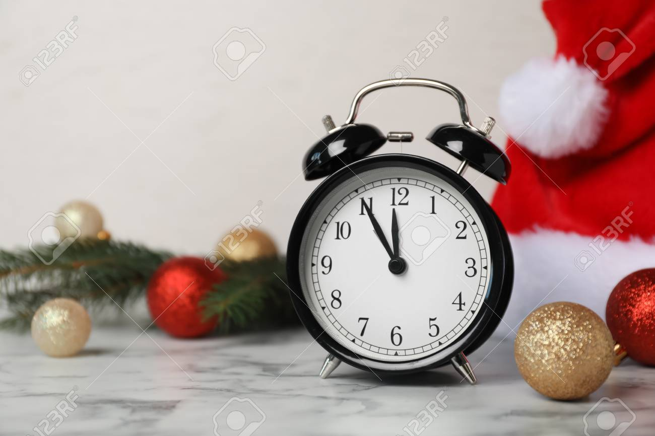 Countdown To Christmas Clock.Alarm Clock And Festive Decor On Table Christmas Countdown