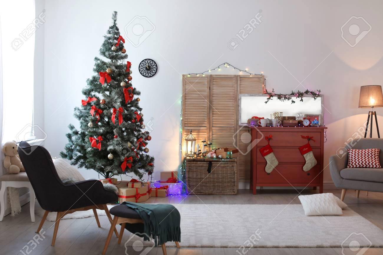 Stylish living room interior with decorated Christmas tree - 106347907