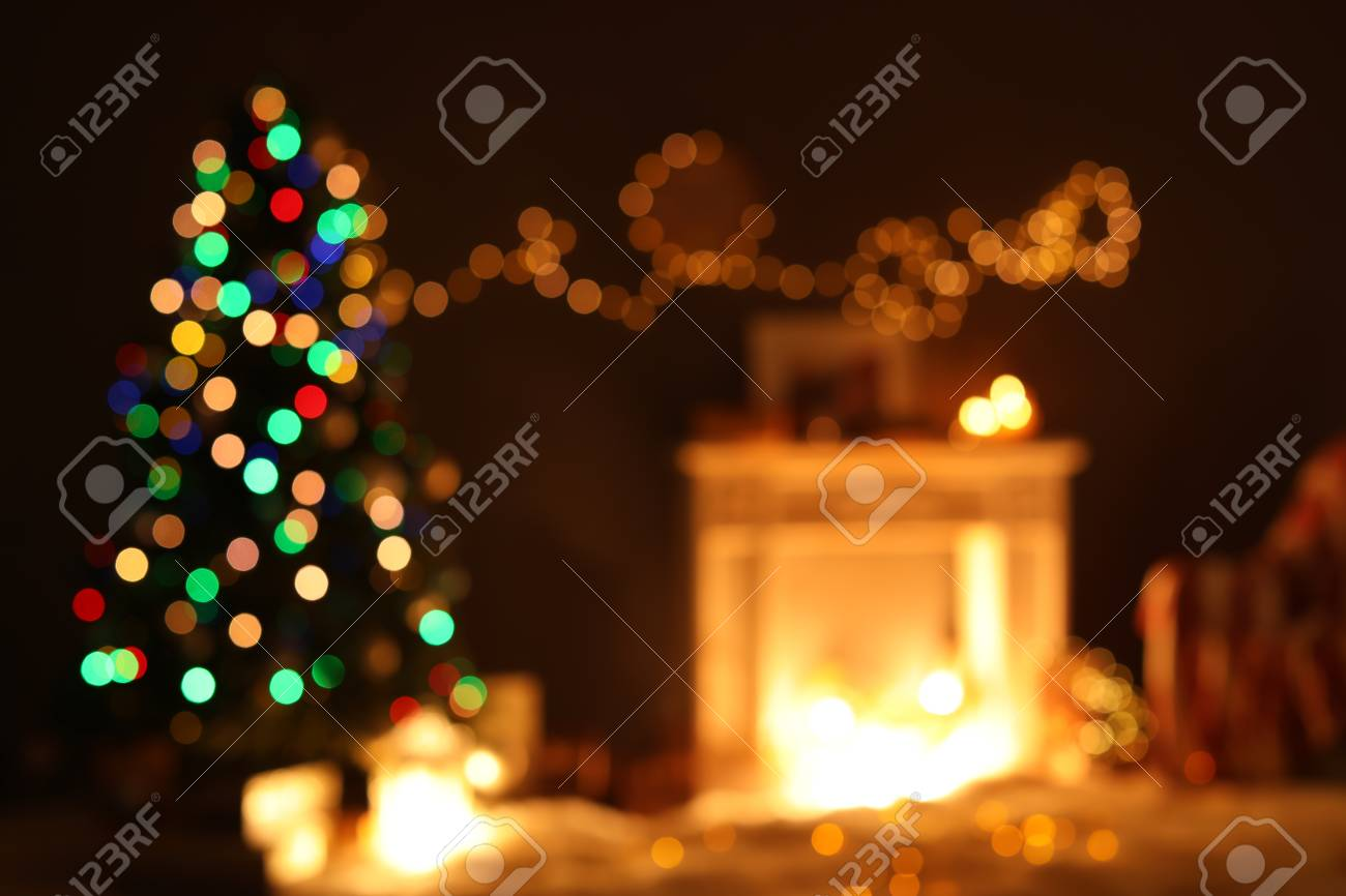 Blurred View Of Stylish Living Room Interior With Christmas Lights