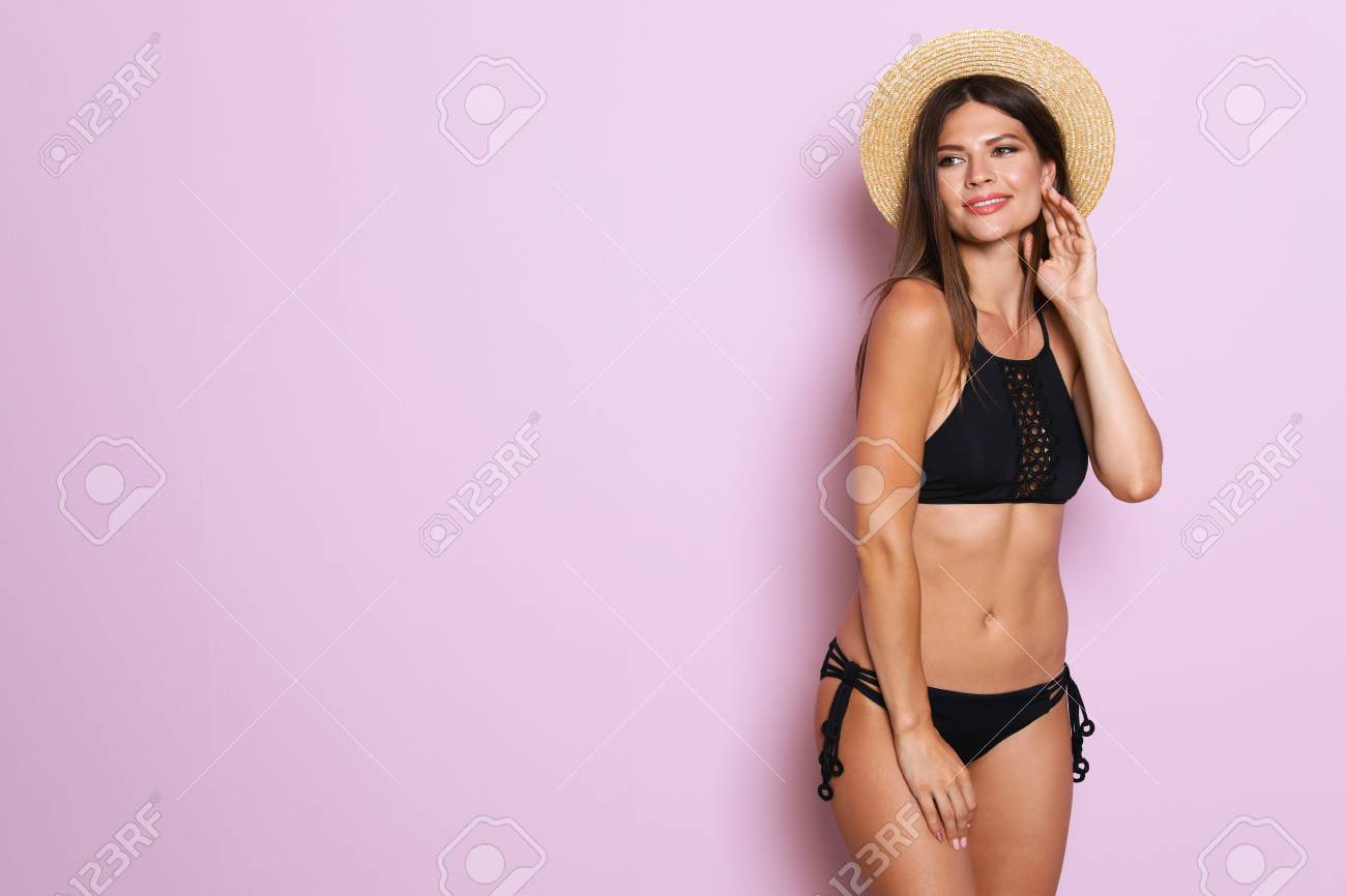320862f66b Sexy young woman in bikini on color background