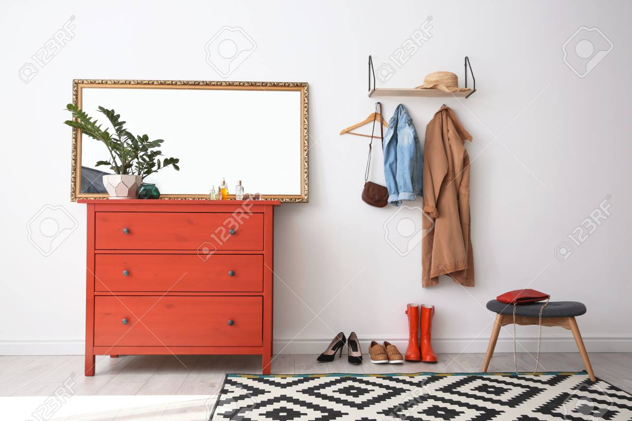 new product 3c193 ce503 Stylish hallway interior with mirror and chest of drawers