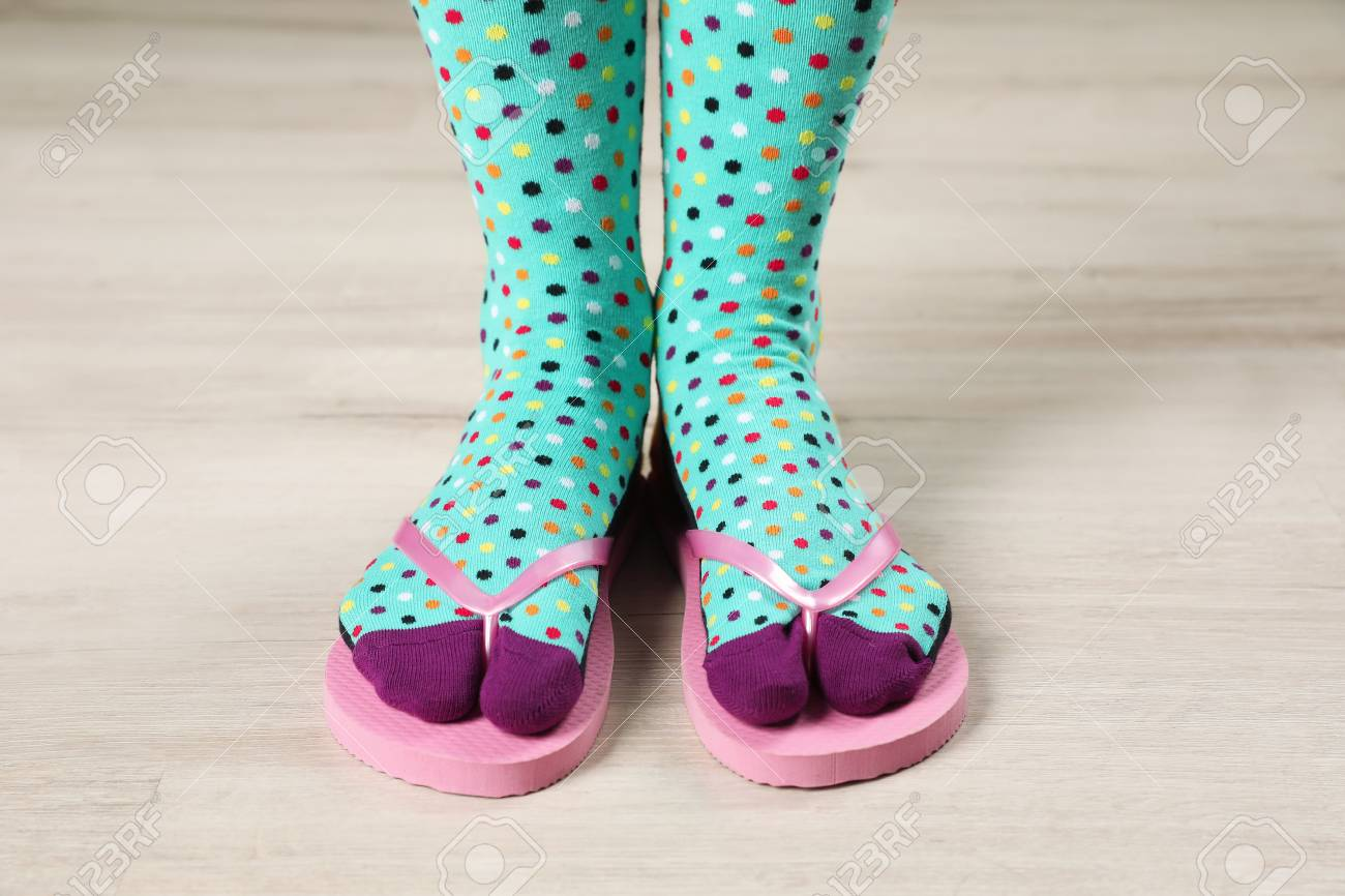 Woman Wearing Bright Socks With Flip