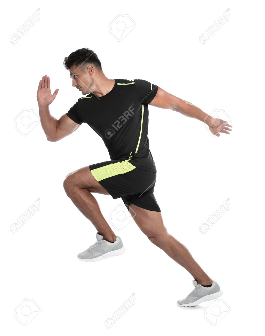 Sporty young man running on white background - 107022095