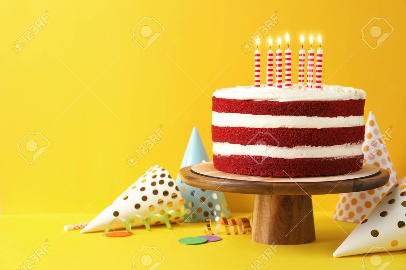 Delicious Homemade Red Velvet Cake With Candles On Yellow Background Space For Text Stock Photo