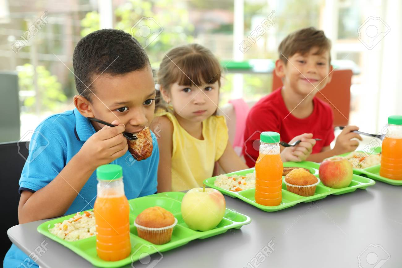 Stupendous Children Sitting At Table And Eating Healthy Food During Break Download Free Architecture Designs Embacsunscenecom