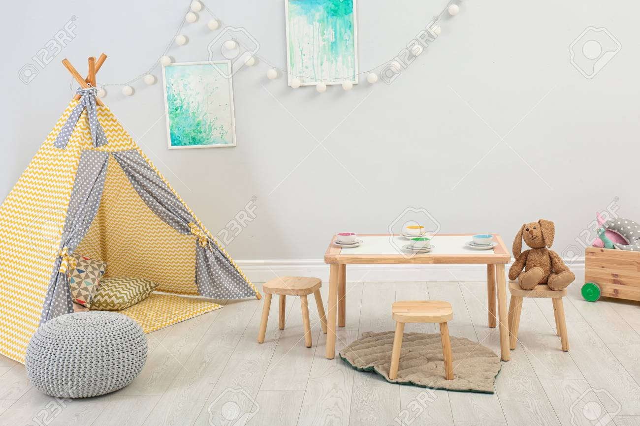 on sale 33001 54f18 Cozy kids room interior with table, play tent and toys