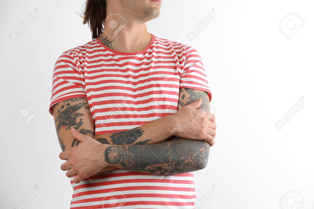 Young man with stylish tattoos on white background - 110698986
