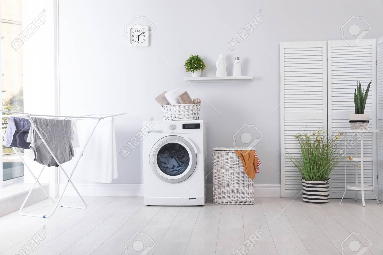 Laundry room interior with washing machine near wall - 110358843