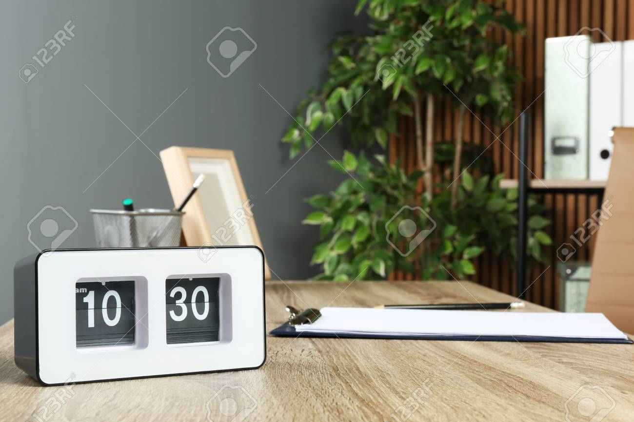Stock Photo   Stylish Flip Clock On Table In Office, Space For Text. Time  Management