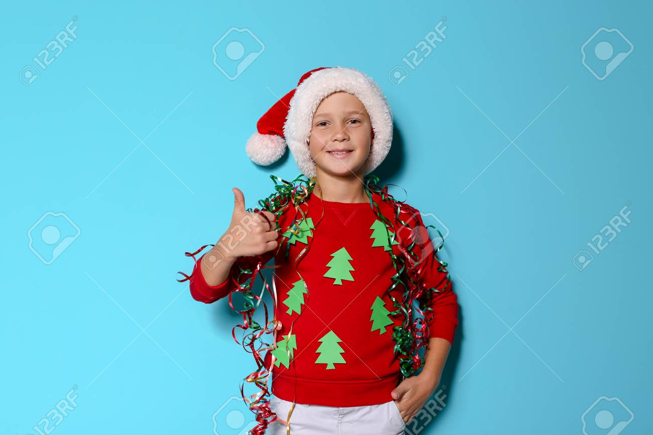 Cute Little Boy In Handmade Christmas Sweater And Hat With Streamers