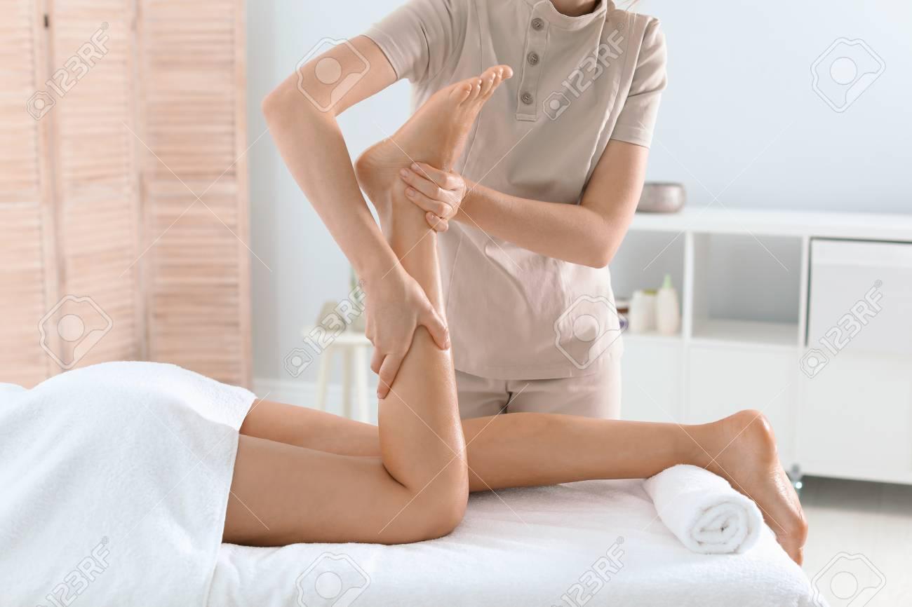 Woman receiving leg massage in wellness center - 110798532