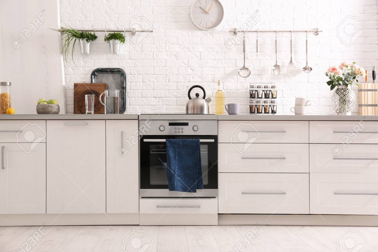 Light modern kitchen interior with new oven - 111263946