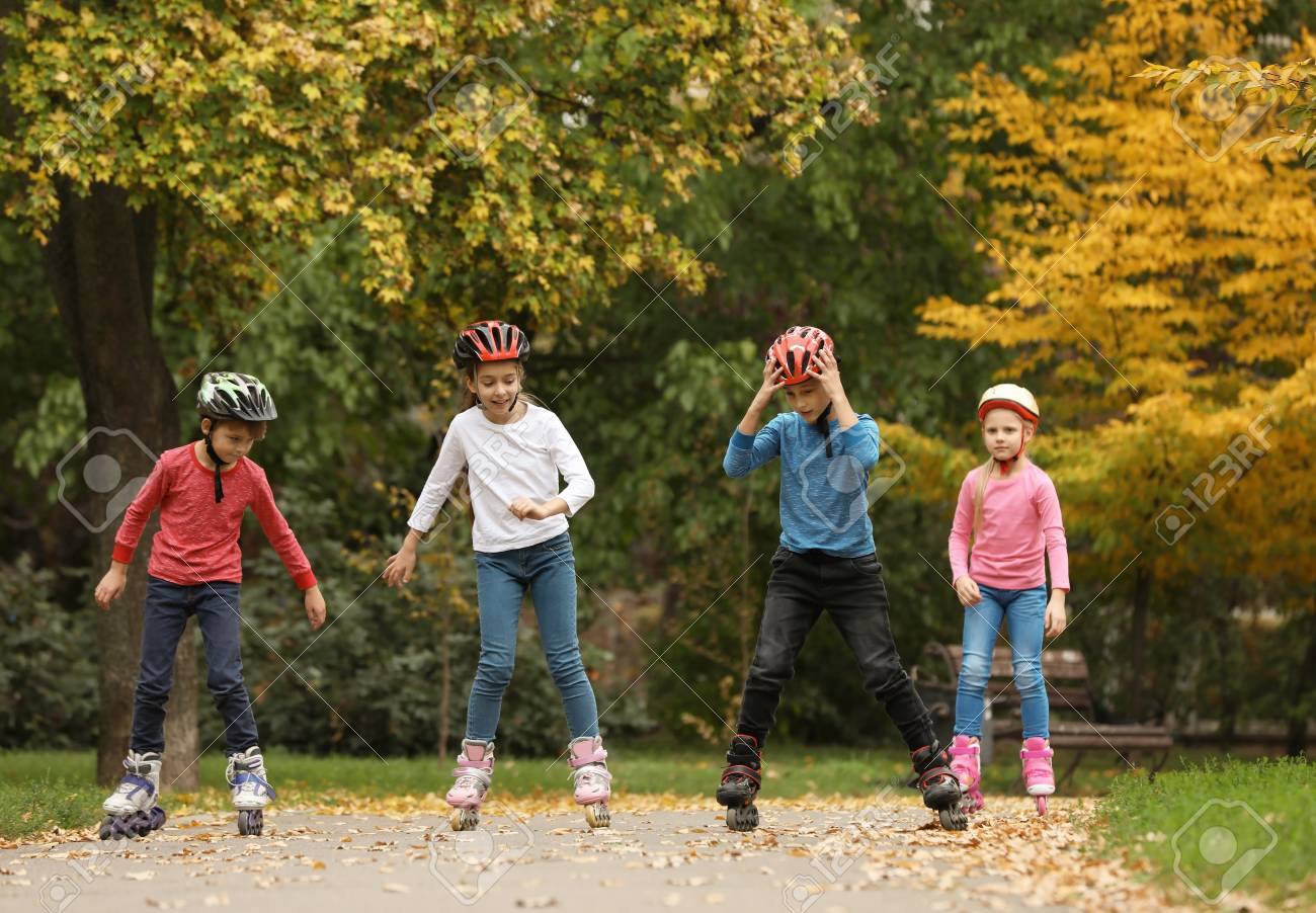 Happy Children Roller Skating In Autumn Park Stock Photo Picture And Royalty Free Image Image 112345170