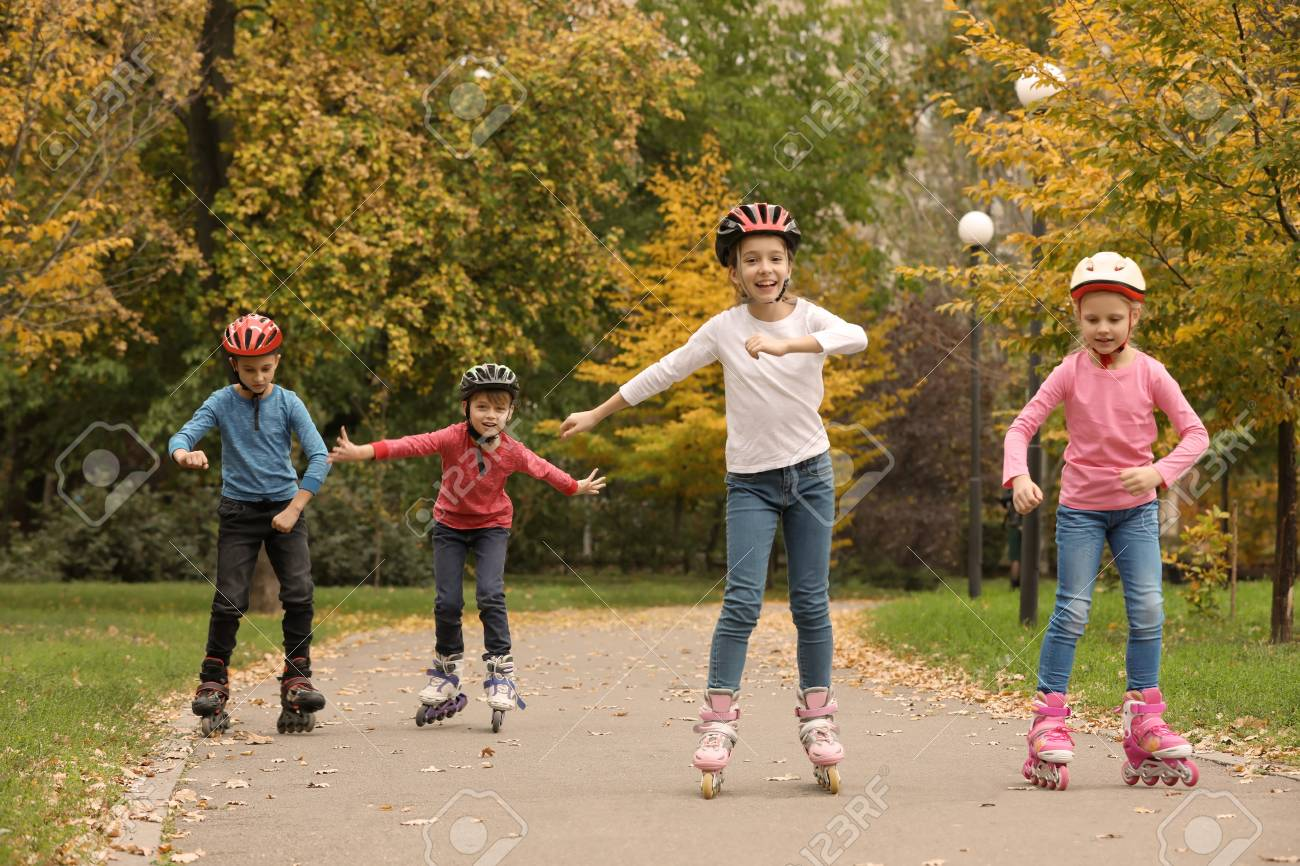 Happy Children Roller Skating In Autumn Park Stock Photo Picture And Royalty Free Image Image 112345348