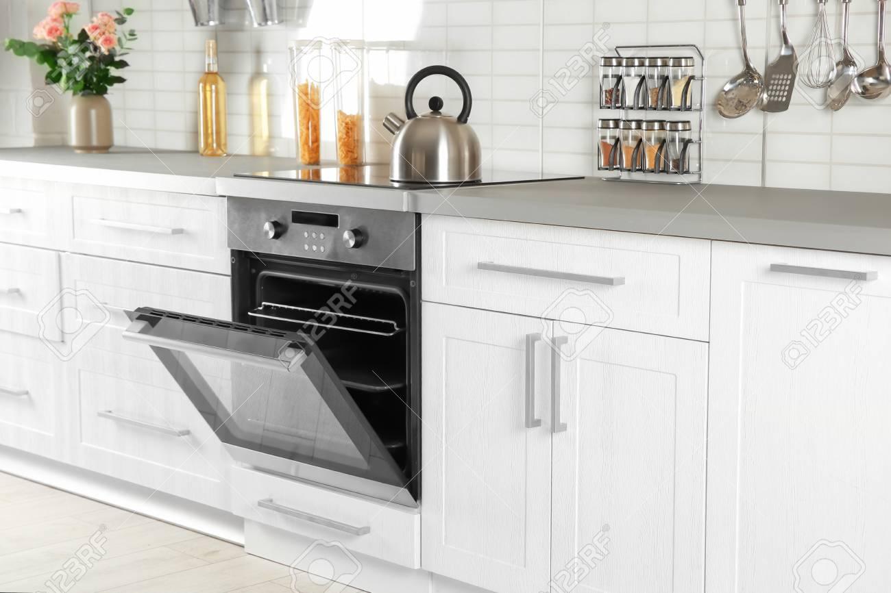 Open modern oven built in kitchen furniture - 111230523