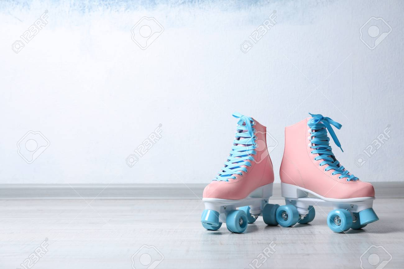 Vintage Roller Skates On Floor Near Color Wall Space For Text Stock Photo Picture And Royalty Free Image Image 112348585
