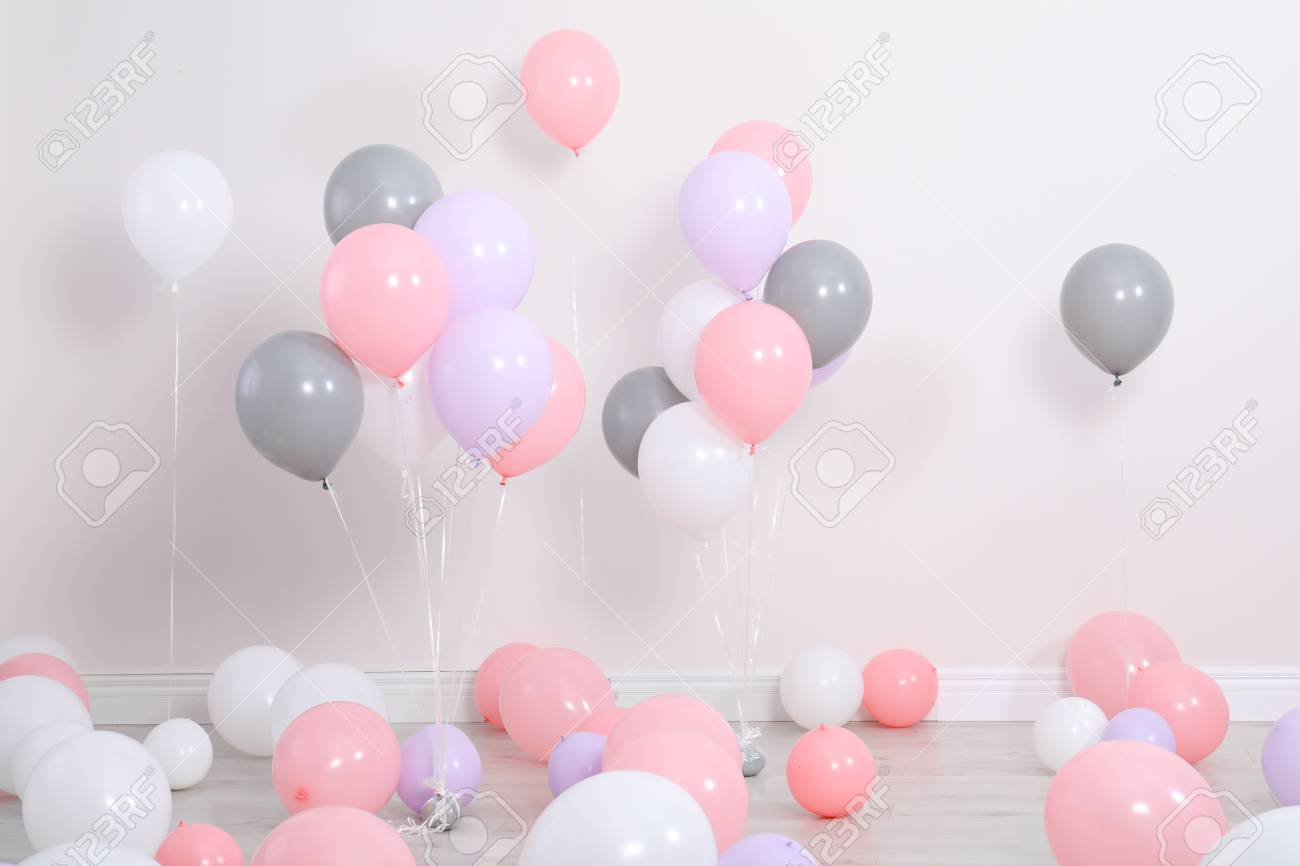 Room decorated with colorful balloons near wall - 113256560