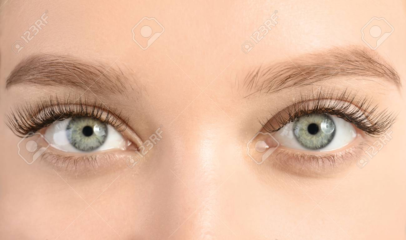 Young woman with beautiful long eyelashes, closeup. Extension procedure - 113446266