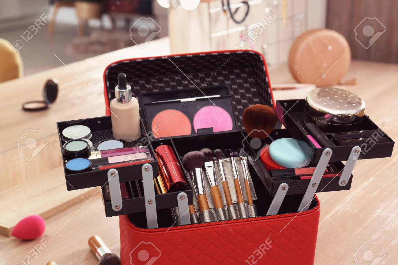 Beautician case with professional makeup products and tools on..