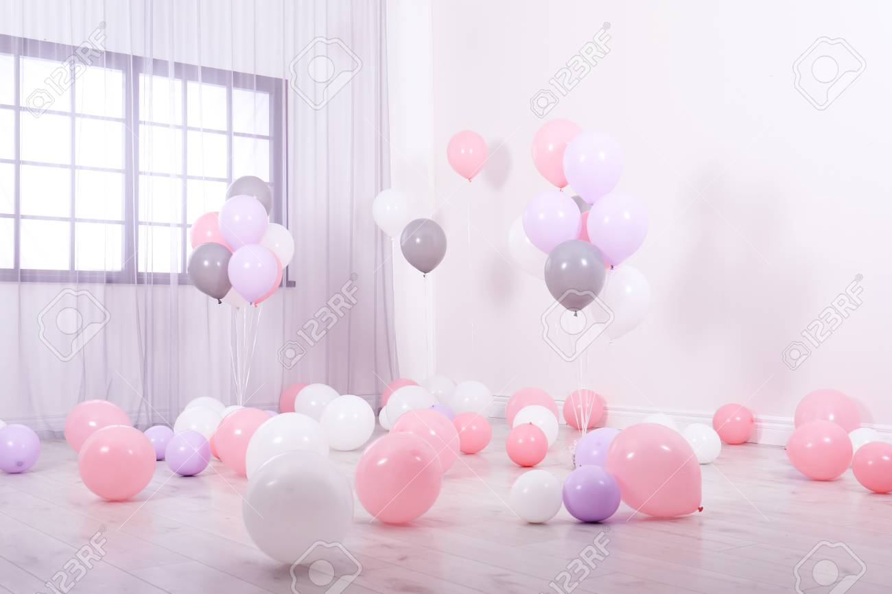 Room decorated with colorful balloons near wall - 113845135