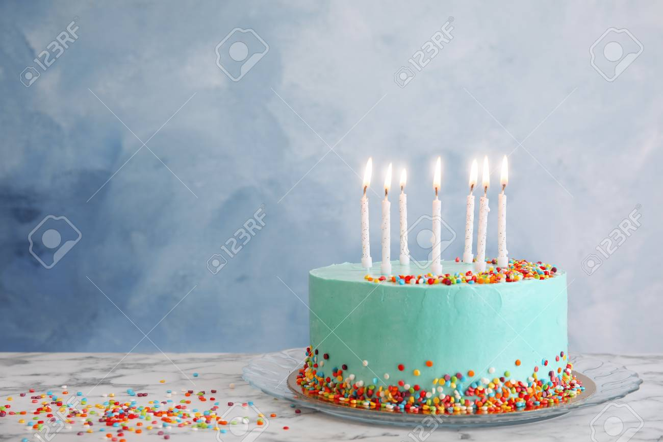 Birthday Cake With Candles.Fresh Delicious Birthday Cake With Candles On Table Against Color