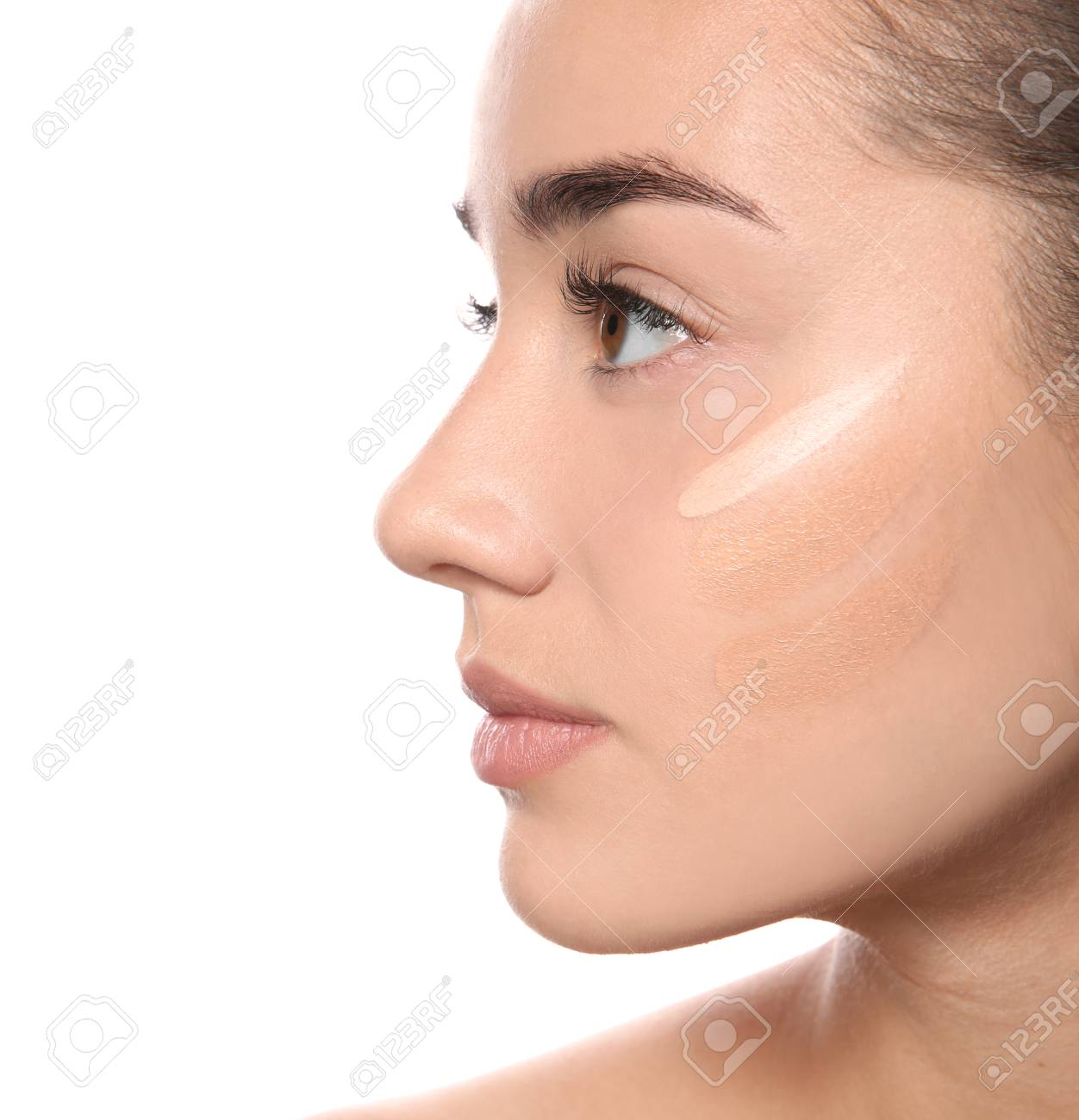 Young Woman With Different Shades Of Skin Foundation On Her Face