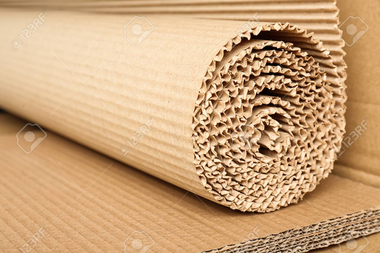 Roll of brown corrugated cardboard, closeup  Recyclable material