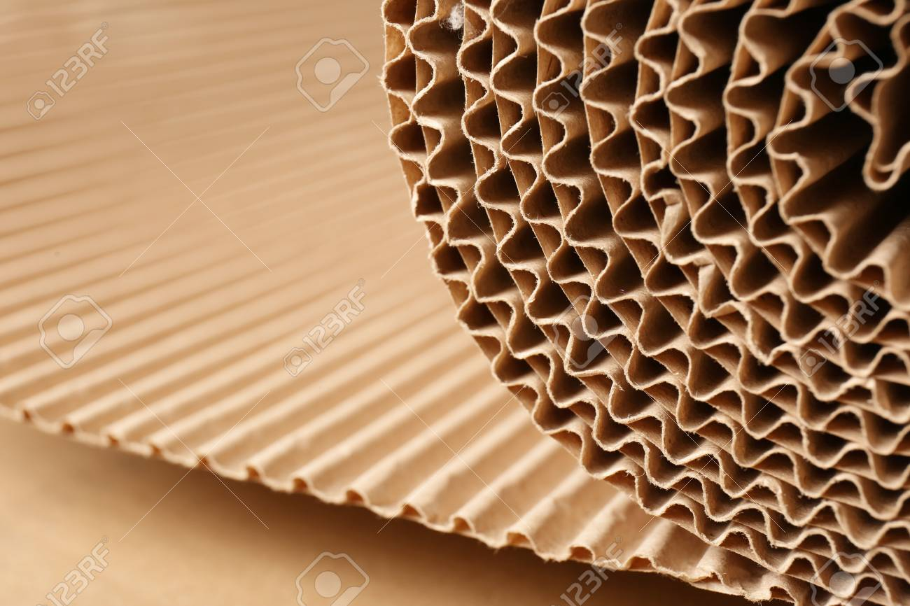 Closeup view of roll of brown corrugated cardboard, space for