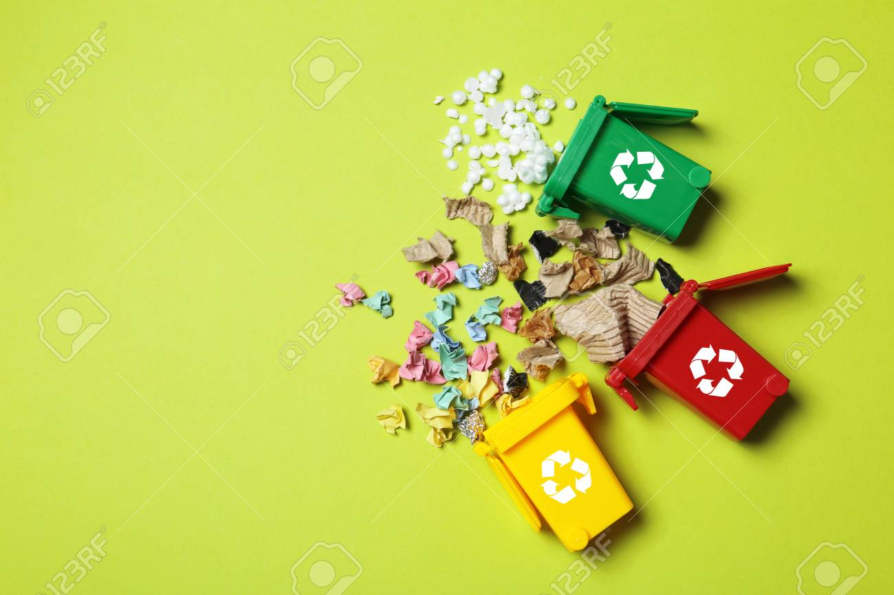 Trash bins and different garbage on color background, top view with space for text. Waste recycling concept - 114539578